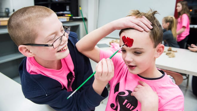Andrew Nawn, 11, paints on his friend, Nicholas Townsend, 12, during the For Emma Dance-A-Thon 2018 at Hanover Middle School on Jan. 19, 2018. The annual event raises money for an academic scholarship in memory of Emma Martinez, a 2000 Hanover graduate who died in a car crash in 2003.