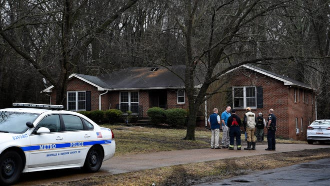 Investigators inspect the house where three people were killed in a fire on Southwood Drive in Nashville, Tenn., Wednesday, Feb. 14, 2018.