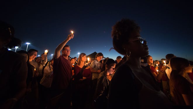 A candlelight vigil draws thousands to the Pine Trails Park amphitheater Thursday, Feb. 15, 2018, to mourn a day after the mass shooting at Marjory Stoneman Douglas High School in Parkland.