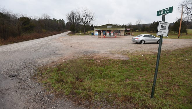 A Baxter County deputy was at this Lone Rock convenience store Tuesday evening shortly before confronting and fatally shooting a man allegedly armed with a crossbow who was driving a stolen tractor. The shooting occurred on the road seen to the left of the store.