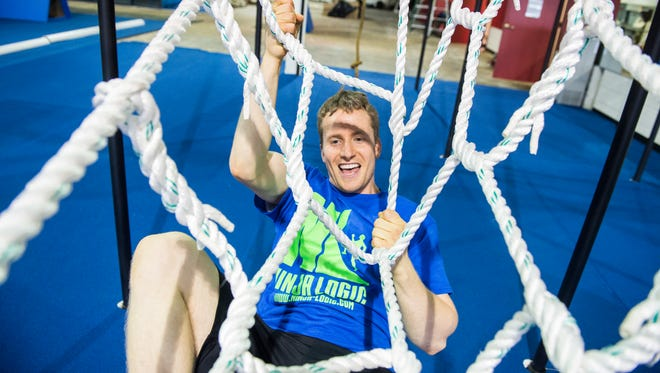"""Chad Riddle climbs on a cargo net obstacle at Ninja Logic, a new ninja warrior gym in Hanover. Riddle, 28, competed on the NBC show """"American Ninja Warrior"""" in 2014 and was given a second opportunity to be on the show this past spring."""