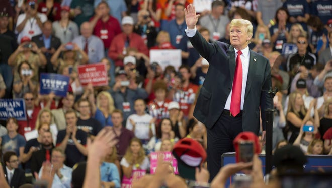 President Donald Trump waves to supporters as he leaves the stage after speaking during a rally at an arena in Duluth, Minn., June 20, 2018.