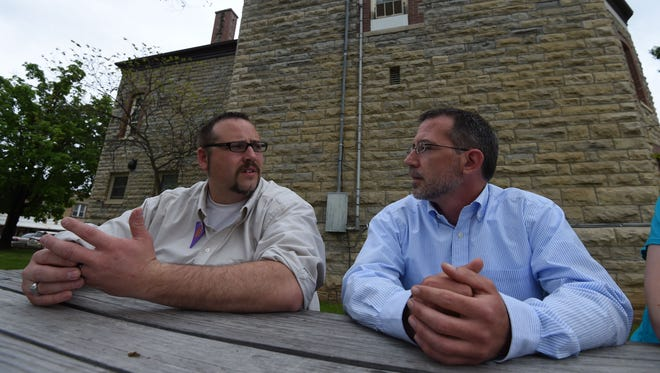 Robert Long, left, and James Adkerson talk Thursday outside the Marion County Courthouse during a break in the Christina Scroggin murder trial. While both men testified on Day 4 of the trial, they didn't get to tell jurors Scroggin was prone to jealous rages and that they feared for Raul Turrieta's life.