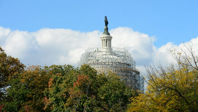 The U.S. Capitol Dome  under a scaffold system that surrounds the exterior of the Dome currently under renovation.
