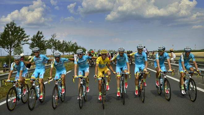 Italy's Vincenzo Nibali, center, rides with his Astana teammates prior to the start of the last stage of  the 2014 Tour de France.