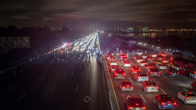 Protesters rallying against police violence block both directions of Interstate 80 in Berkeley, Calif., on Monday.