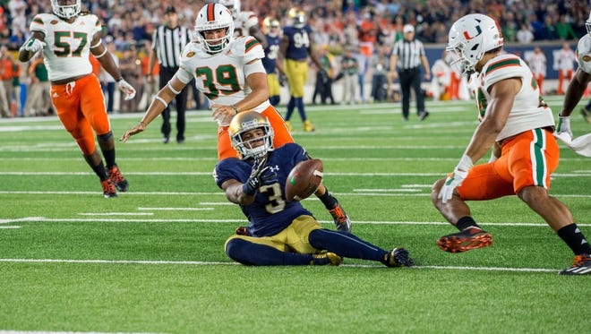 Oct 29, 2016; South Bend, IN, USA; Notre Dame Fighting Irish wide receiver C.J. Sanders (3) fumbles a punt in the fourth quarter against the Miami Hurricanes at Notre Dame Stadium. Notre Dame won 30-27. Mandatory Credit: Matt Cashore-USA TODAY Sports