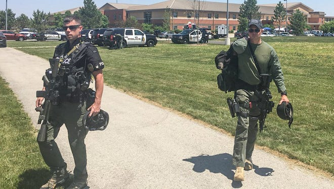 Law enforcement pack up their belongings at Noblesville West Middle School.