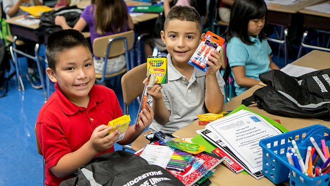 Students at Tusculum Elementary School in Nashville receive school supplies during the 2015 Stuff the Bus campaign.