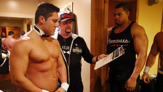 Chippendale manager Tony Valentine goes over the dance numbers with Eli Johnson and Brandon Stone before a performance at Miss Kitty's in.