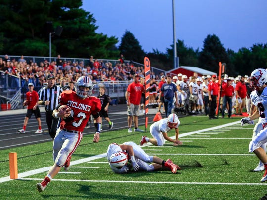 Nick Foss scores a touchdown for Harlan during a game