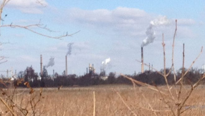The PBF Energy refinery near Delaware City is viewed Thursday across Dragon Run marsh.