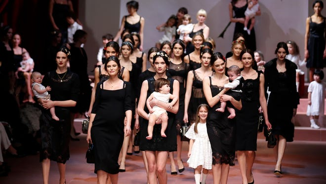 Models wear creations for Dolce&Gabbana women's Fall-Winter 2015-16 collection, part of the Milan Fashion Week, unveiled in Milan, Italy, Sunday, March 1, 2015.