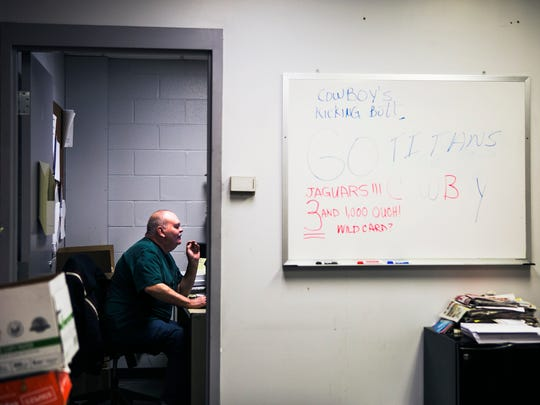Paul Futrell, 64, works in his office in the mail room on Thursday morning.