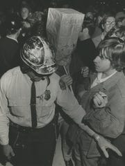 Police block about 600 people who had gathered to protest the dedication of Milwaukee's $12 million Performing Arts Center on Sept. 17, 1969. The protesters objected to what they called spending for the privileged few. Police kept demonstrators away from 2,000 arts patrons who attended $100-a-seat opening night.