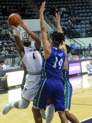 ACU's Jaylen Franklin, left, shoots over Texas A&M-Corpus