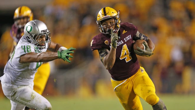 ASU's Demario Richard (4) runs past Oregon's DeForest Buckner (44) for a touchdown at Sun Devil Stadium in Tempe, AZ on October 30, 2015.