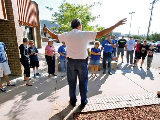 "Rudy Gutierrez—El Paso Times Jaime Barceleau, foreground, chairman of the El Paso school district's Yes for Kids campaign talks with a group of volunteers who turned out for the campaign's kick-off at the Paso del Norte Children's Development Center at 1101 E. Schuster Saturday. The effort urges voters to approve an upcoming tax ratification election nicknamed ""penny swap.""  About 20 people turned out to go block walking to various areas of the district. Dori Fenenbock, school board president attended as well as board members Susie Byrd, Al Velarde, Bob Geske and Trent Hatch."