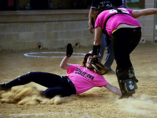 Red Lion's Lyndsey Teal, right, tags out Dallastown's Haylee Anders at home during the fourth inning of Wednesday's game at Red Lion. Anders hit a two-run home run for her 100th career hit, helping the Wildcats earn a 15-5, five-inning victory. It was the 100th career win for Dallastown coach Jeff Deardorff.