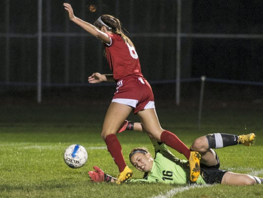 Annville-Cleona's Regan Hess gets by Northern Lebanon goalie Karen Natale to score her final goal Wednesday in the Little Dutchmen's 4-3 win.