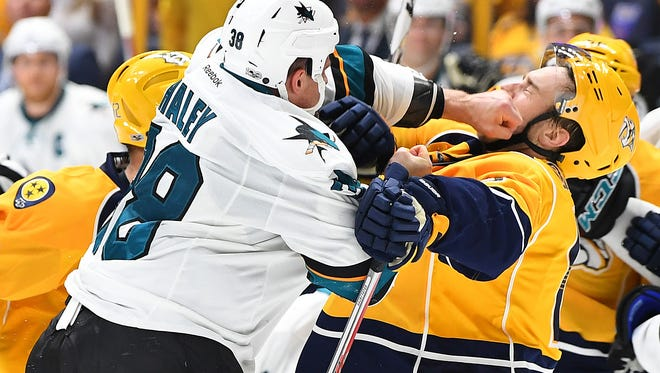 Predators center Calle Jarnkrok is hit after the play by San Jose Sharks center Micheal Haley during the third period on March 25, 2017.