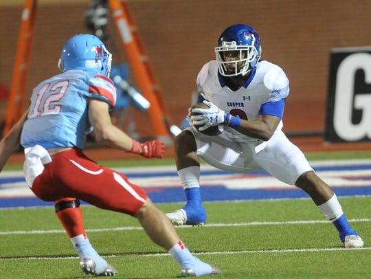 Cooper's Tyrees Whitfield, right, tries to evade Lubbock