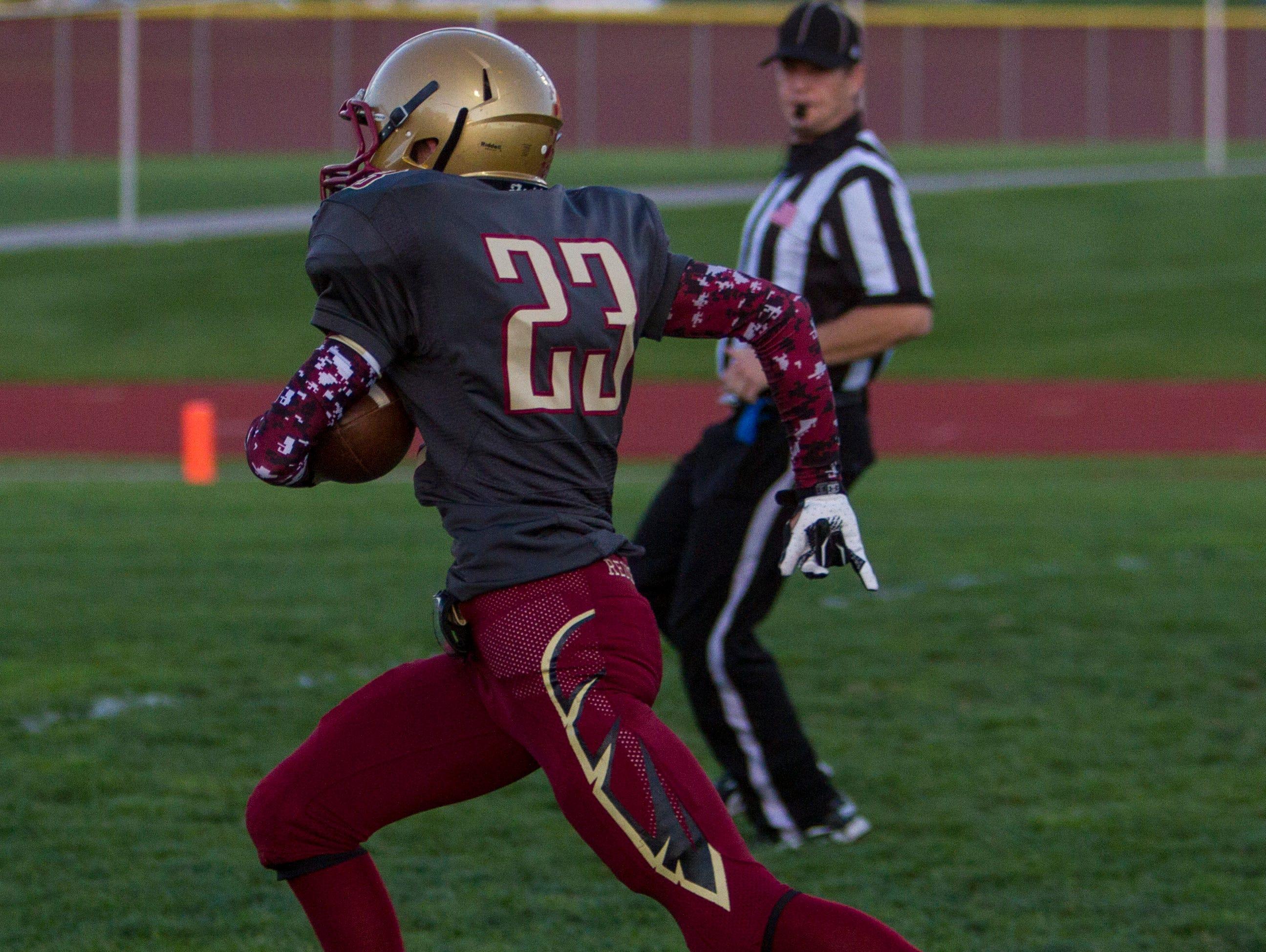Cedar's Bracken Yardley (#23) runs for a touchdown against Snow Canyon, Friday, Sept. 25, 2015.