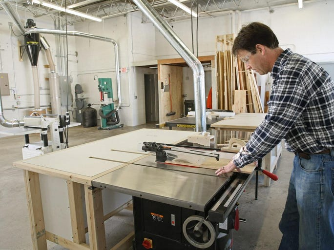 Dan Meissner cuts wood for one of his own projects on a cabinet saw in the shop.