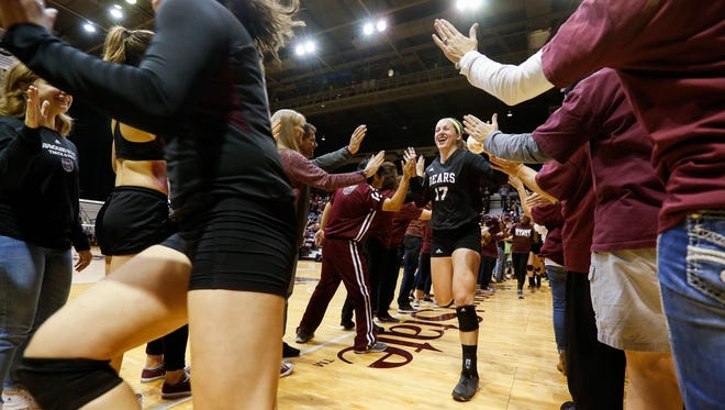 Lily Johnson (17) high fives fans as the Missouri State University volleyball team is introduced before their match against the University of Northern Iowa on Saturday, Nov. 11, 2017.