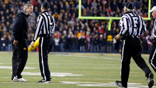 Iowa coach Kirk Ferentz disagrees with officials during Saturday's game against Wisconsin.