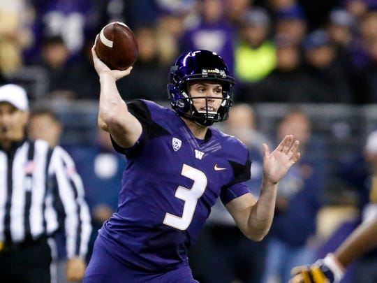 Washington quarterback Jake Browning throws out a pass against California on Saturday.