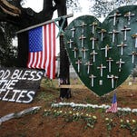 A memorial is displayed near the Sandy Hook Elementary School on Jan. 14, 2013, a month after the mass shooting that left 26 dead, including 20 children in Newtown, Connecticut.