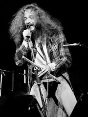 """Ian Anderson, leader of Jethro Tull, contorts wildly while performing """"Thick as a Brick"""" that lasted 75 minutes and included two comedy routines, a 15-minute flute solo and seven-minute drum solo in 1972."""