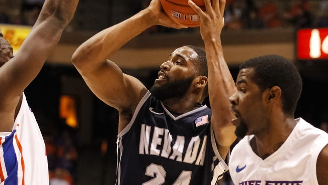 Nevada's Deonte Burton (24) shoots during the first half of an NCAA college basketball game against Boise State in Boise, Idaho, on Wednesday, March 5, 2014.