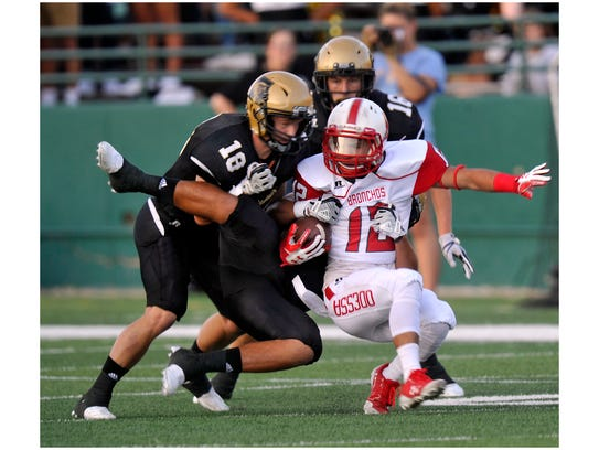 Odessa High School running back Julian Galindo is taken