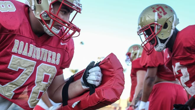 COD lineman Robbie Polimeni, left, at practice on Tuesday, October 25 at College of the Desert in Palm Desert.