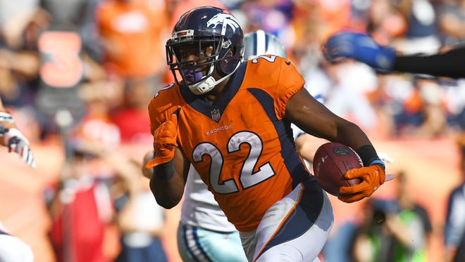 Denver Broncos running back C.J. Anderson (22) carries the ball in the second quarter against the Denver Broncos at Sports Authority Field at Mile High.