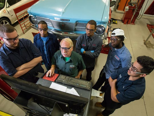 Automotive instructor Jack Malloy is surrounded by students (from left) Justin Fletcher, Luis Deschamps, Will Caudle, Jay Dollard and Jose Salazar at Delaware Technical Community College's Stanton campus.