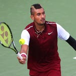 Nick Kyrgios of Australia hits a shot against John Isner of the United States (not pictured) during the Rogers Cup in Montreal on Aug. 13, 2015.