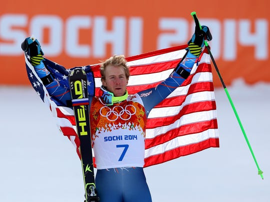 Gold medalist Ted Ligety of the United States celebrates during the flower ceremony for the the Alpine Skiing Men's Giant Slalom on day 12 of the Sochi 2014 Winter Olympics at Rosa Khutor Alpine Center on Feb. 19, 2014 in Sochi, Russia.