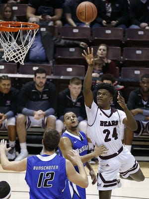 Alize Johnson piled up 21 points and 16 rebounds in Sunday's game against Indiana State, but shots in the final minutes by two of his teammates nailed down the win. News/Leader file photo