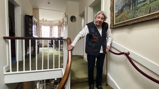 Margaret Payne poses for a photo on the stairs of her home in Sutherland, Scotland. Payne, the 90-year-old grandmother who launched an epic climb to raise money for charity, completed her fundraiser Tuesday, scaling her home's stairs the equivalent of 731 meters (2,398 feet).