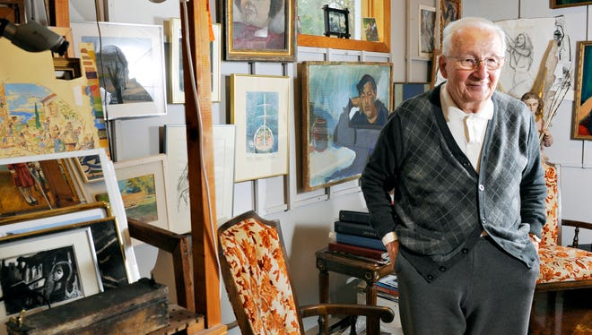 Artist Bela Petheo talks about his paintings Oct. 1 at his studio .
