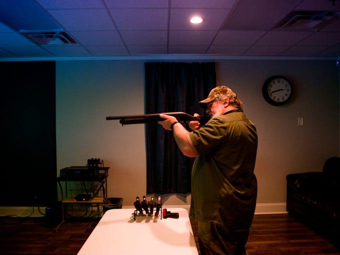 David Tallon, owner of Virtual Shots, shoots ducks