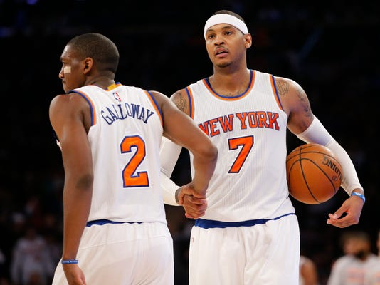 New York Knicks guard Langston Galloway (2) congratulates forward Carmelo Anthony (7) after the Knicks defeated the New Orleans Pelicans 95-87 in an NBA basketball game at Madison Square Garden in New York, Sunday, Nov. 15, 2015. (AP Photo/Kathy Willens)