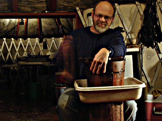 Arden Bailey, founder and owner of Yellowstone Expeditions, makes ice cream in the kitchen yurt.