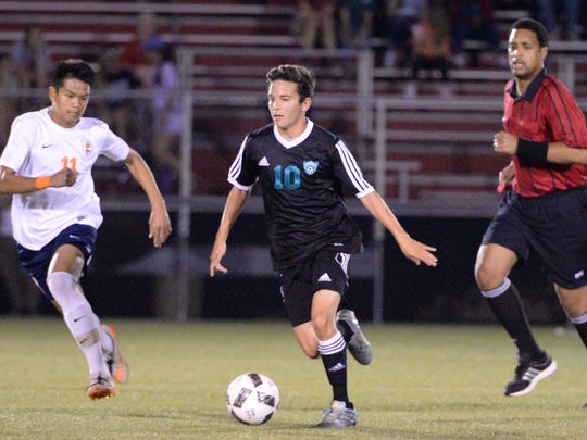 Siegel's Andres Cortes (10) pushes the ball up field