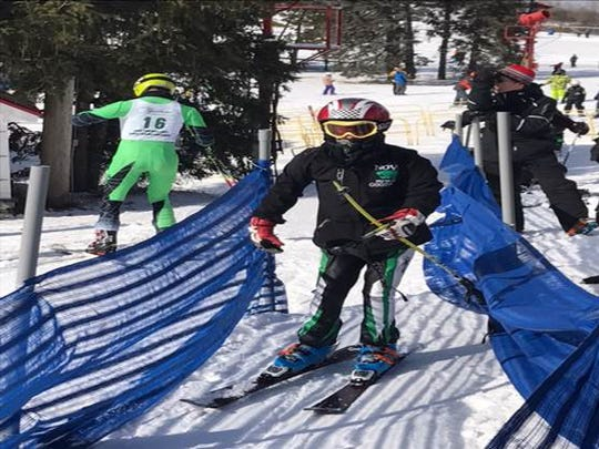 Hunter Goodman, a 16-year old  sophomore at Novi High School competing in his first varsity ski race for the school, skis at Don Thomas JV Invite at Mt Holly Feb 3, 2017. He has been skiing since he was 9.