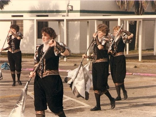 A photo of Vestal Marching Band alumna Wendy Wilkins (left foreground), who spun for the color guard from 1983 through 1987.