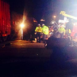 Three people are dead and two more are injured after a train stuck a vehicle in Vandalia, Illinois.